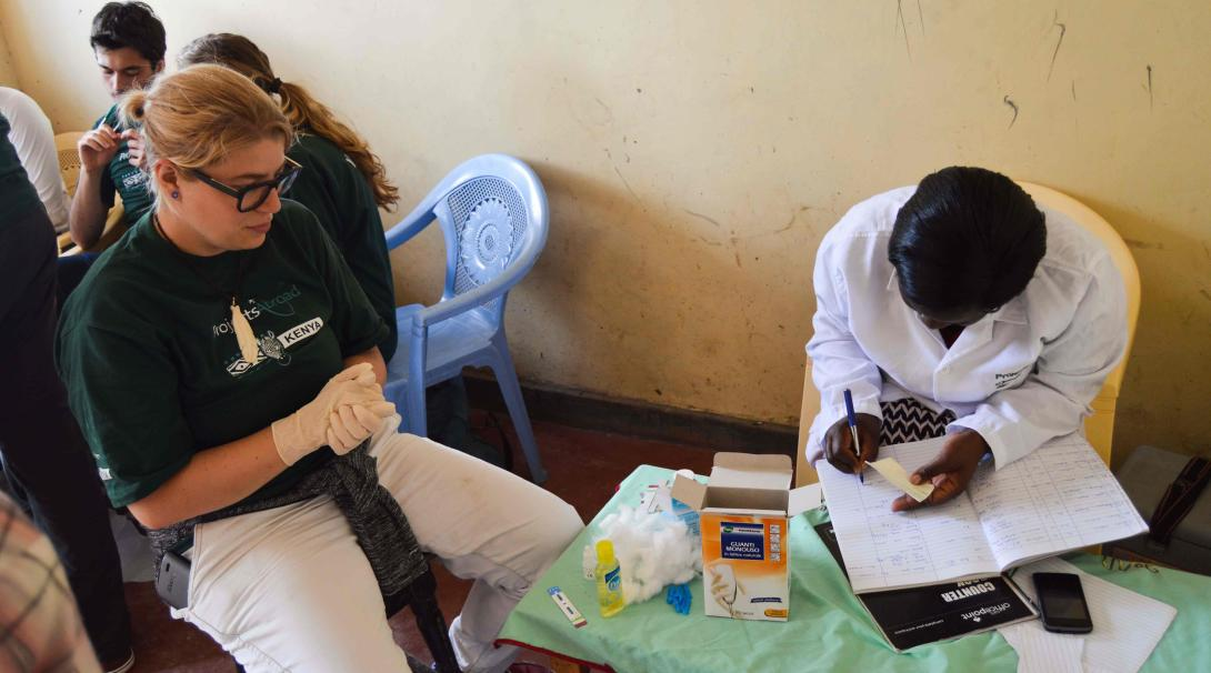 A Projects Abroad medical volunteer doing a Nursing Internship in Kenya shadows a local nurse.